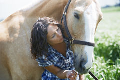 Woman and horse together Royalty Free Stock Photos