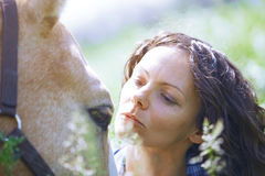 Woman and horse together Stock Image
