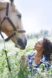 Woman and horse together royalty free stock photography