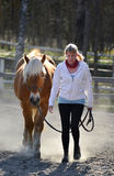 Woman and horse walking Stock Photos