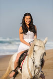 Woman on horse. Young beautiful woman on the horse by the beach Royalty Free Stock Photos