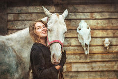 Woman and horse Royalty Free Stock Image