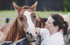 Woman with a horse Royalty Free Stock Image