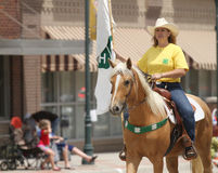 Woman on horseback for 4H in a  parade in small town America Royalty Free Stock Images