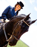 Woman horseback riding Stock Images