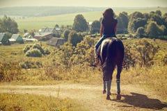 Woman during horseback riding. Stock Photos