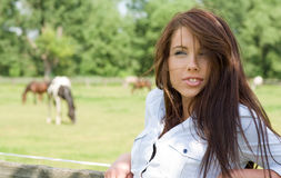 Woman and horses Stock Photography