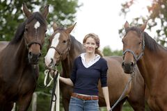 Woman with horses Stock Image