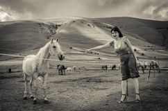 Woman with horses Stock Photography