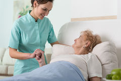 Woman in hospital bed Royalty Free Stock Image