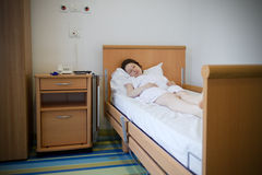 Woman in hospital room. Hospitalized patient woman sleeping in hospital room Stock Photos