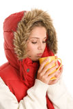 Woman drinking hot beverage Stock Photo