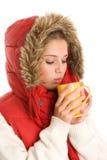 Woman drinking hot beverage Stock Photo