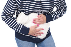 Woman with hot bottle and stomach pain Royalty Free Stock Photos