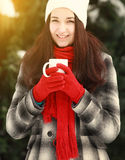 Woman with hot coffee outdoors in winter Royalty Free Stock Photo