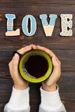 Woman with hot cup of coffee, with biscuits. love concept. Love word with coffee Royalty Free Stock Photo