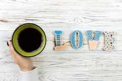 Woman with hot cup of coffee, with biscuits. love concept. Love word with coffee Royalty Free Stock Photos