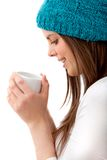 Woman with hot drink Stock Image