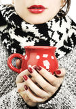 Woman with hot drink in winter Stock Photos
