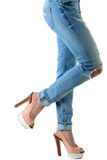 Woman in hot pink  high heels and jeans. Closeup of lower half body isolated on white background Royalty Free Stock Photography