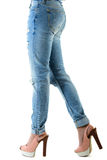 Woman in hot pink  high heels and jeans. Closeup of lower half body isolated on white background Royalty Free Stock Image
