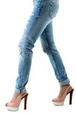 Woman in hot pink  high heels and jeans. Closeup of lower half body isolated on white background Stock Image
