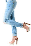 Woman in hot pink  high heels and jeans. Closeup of lower half body  on white background Stock Photos