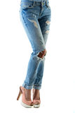 Woman in hot pink  high heels and jeans. Closeup of lower half body  on white background Royalty Free Stock Photography