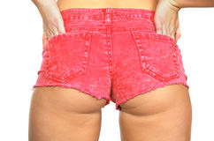 Woman hot pink shorts. Woman wearing very short, hot pink shorts.  White background Stock Photos