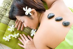 Woman in hot stone therapy Royalty Free Stock Image