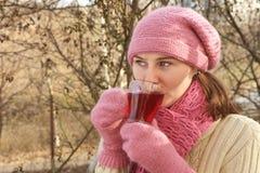 Woman with hot tea Royalty Free Stock Photos