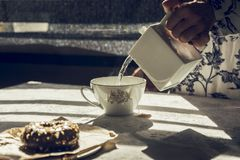 Woman with hot water teapot preparing tea Royalty Free Stock Photo