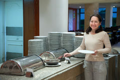 Woman at hotel buffet Stock Photo