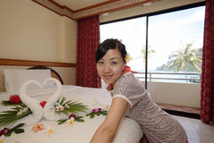 Woman in hotel room Stock Image