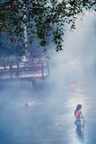 Woman in Hotsprings. A woman in a natural hotsprings Stock Photography