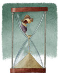 Woman in hourglass Stock Photo