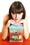 Woman  with a house. Auburn haired girl, young woman  with a house Stock Image
