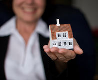 Woman and house Stock Images