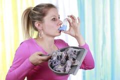 Woman with house dust allergy and asthma spray Stock Photos
