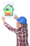 Woman with a house energy sign Royalty Free Stock Image