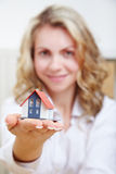 Woman with house on hand Royalty Free Stock Photo