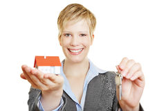 Woman with house and keys Stock Photo