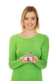 Woman with house model. Royalty Free Stock Photos