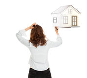 Woman with house sketch Royalty Free Stock Images