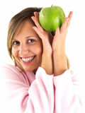 Woman in housecoat with apple Stock Images