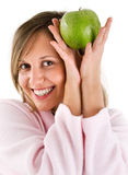 Woman in housecoat with apple Royalty Free Stock Photos