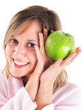 Woman in housecoat with apple Stock Photo