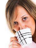 Woman in housecoat with coffee Stock Images