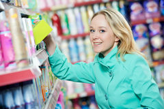Woman at household chemistry shopping Royalty Free Stock Photography