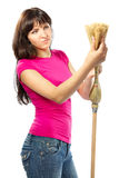 Woman housewife checking  broom. Woman housewife checking straw broom. Over white background Stock Photos